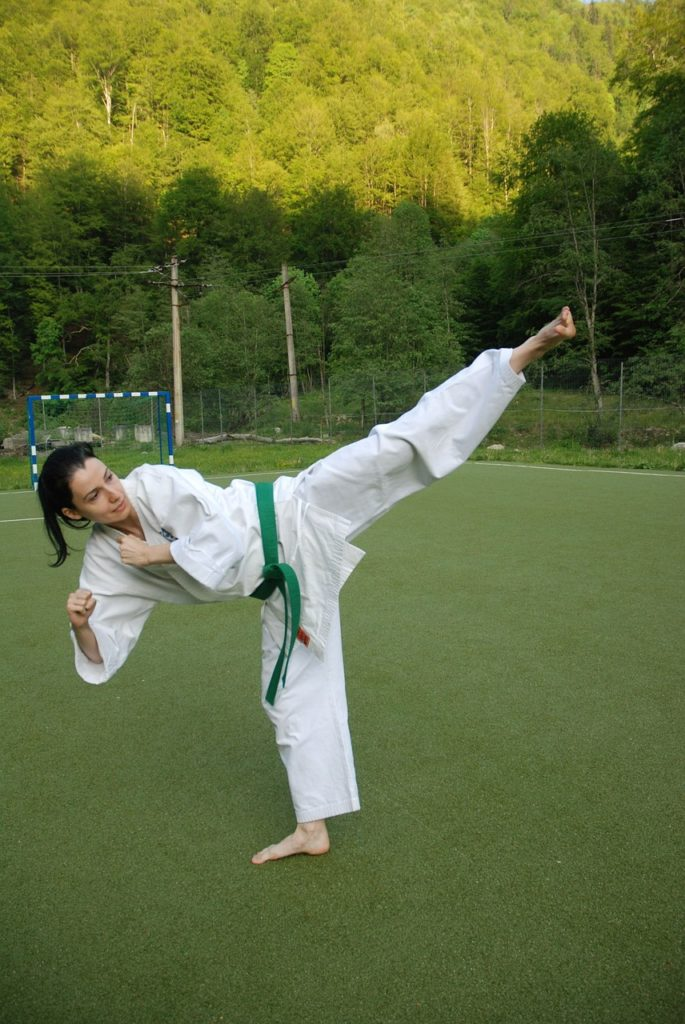 woman doing karate side kick