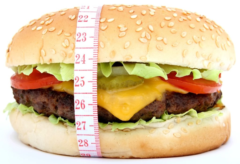 Measuring tape around hamburger.